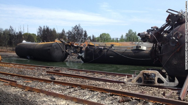 Derailed rail cars  sit in mud and oil in Lac Megantic, Quebec, Canada, on Monday, July 8, in this handout image released by the Transportation Safety Board of Canada.