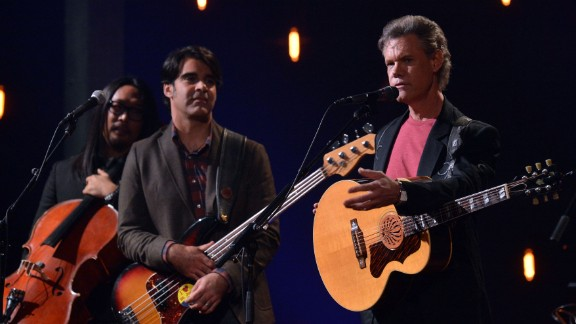 """Travis performs with the Avett Brothers during a taping of """"CMT Crossroads"""" in Franklin, Tennessee, on October 24, 2012."""