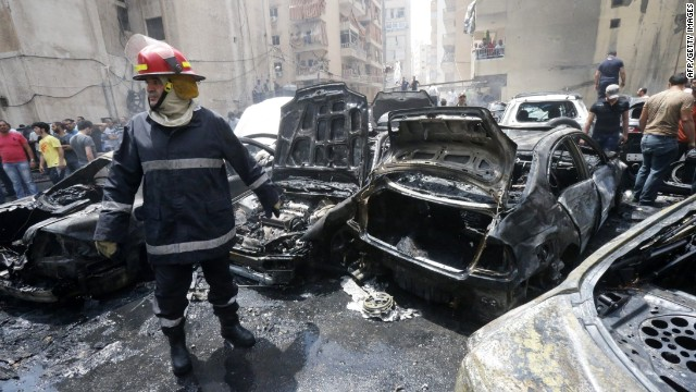 Burned vehicles at the site of an explosion in Beirut's southern suburb neighbourhood of Bir al-Abed on July 9, 2013.
