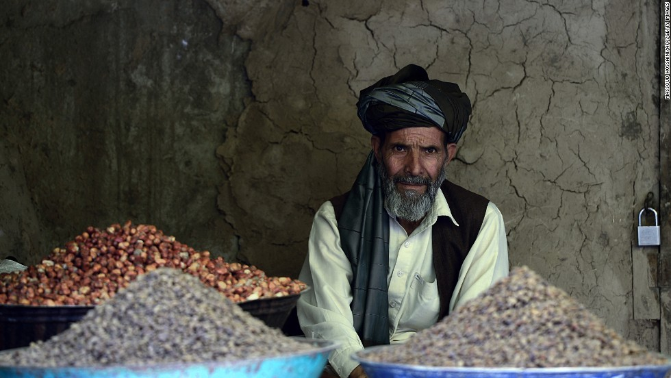 A man selling dried fruit waits for customers in an old market in Kabul, Afghanistan, on Monday, July 8.