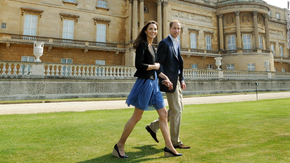 The newlyweds walk hand in hand from Buckingham Palace the day after their wedding in April 2011.
