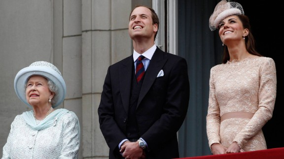 The Queen, William and Catherine stand on the balcony of Buckingham Palace during the finale of the Queen