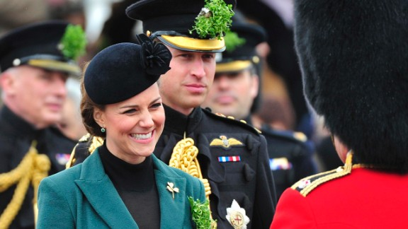 The couple attends a St. Patrick's Day parade as they visit Aldershot, England, in March 2013.