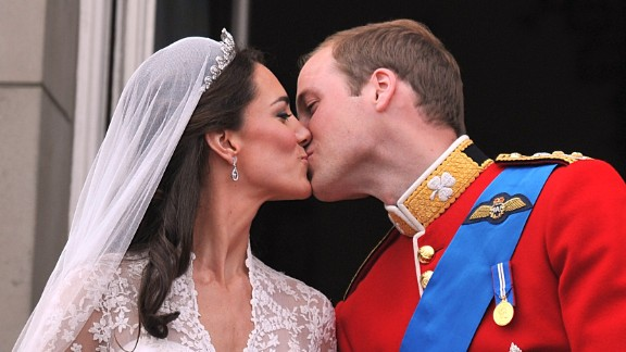 William and Catherine kiss on the balcony of Buckingham Palace after their wedding ceremony in London.