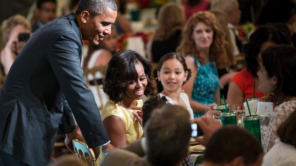 """President Barack Obama and first lady Michelle Obama chat with guests during the second kids' """"state dinner"""" on Tuesday, July 9, at the White House. Fifty-four children, along with their parents and guardians, attended as winners of the Healthy Lunchtime Challenge."""
