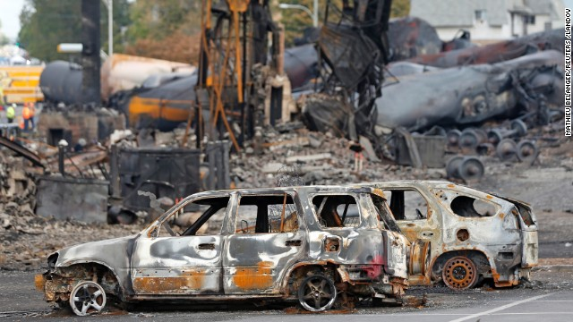 Burnt cars are seen near the train wreckage in Lac Megantic, July 9, 2013. The crude oil freight train that derailed and blew up in the small town of Lac-Megantic early on Saturday morning was traveling far too fast when it went off the rails, investigators told reporters on Tuesday. REUTERS/Mathieu Belanger ( CANADA - Tags: DISASTER TRANSPORT) REUTERS /MATHIEU BELANGER /LANDOV   Photographers/Source: MATHIEU BELANGER/Reuters /Landov