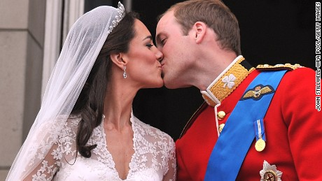 Prince William and Catherine share a wedding day kiss on the balcony at Buckingham Palace, London, in April 2011.