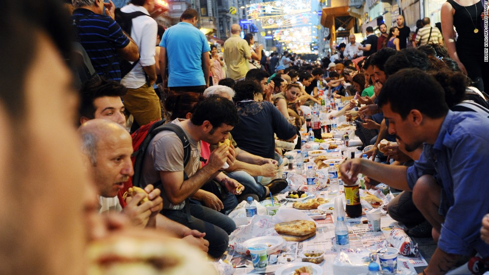 Anti-government protesters in Turkey take a break from their first day of fasting during Ramadan after sunset on July 9 in Istanbul.