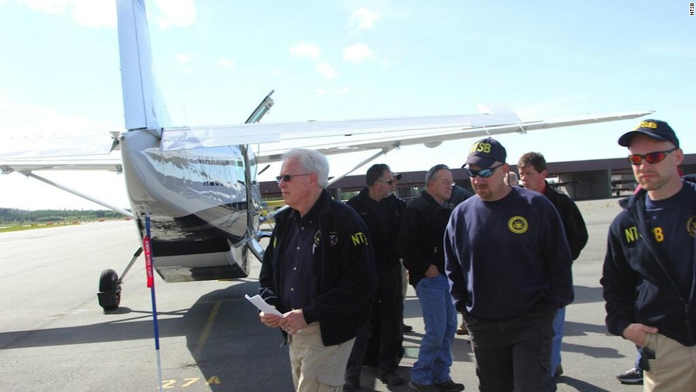 The NTSB released images from the crash site and early details via Twitter on Tuesday, July 9. Here, NTSB member Earl F. Weener and investigators arrive at the scene.