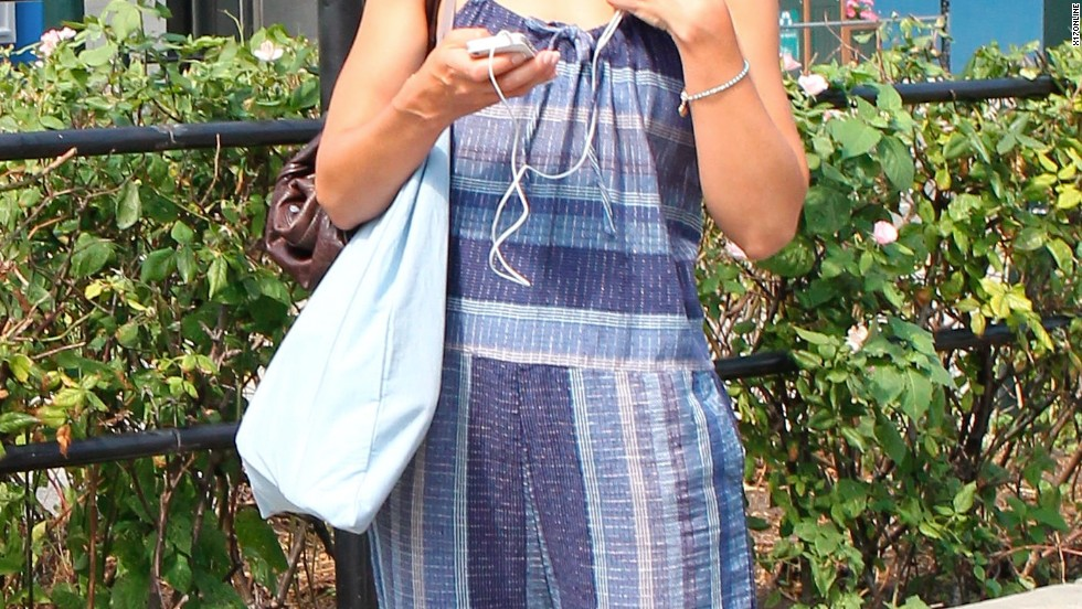 Katie Holmes checks out her phone while in New York on July 9.