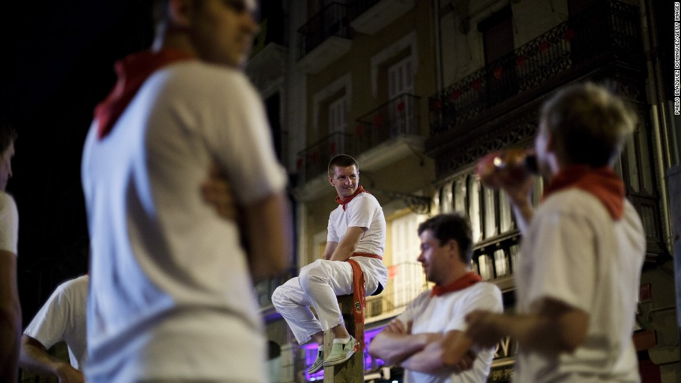 People gather on July 10 before the start of the fifth day of the running of the bulls.