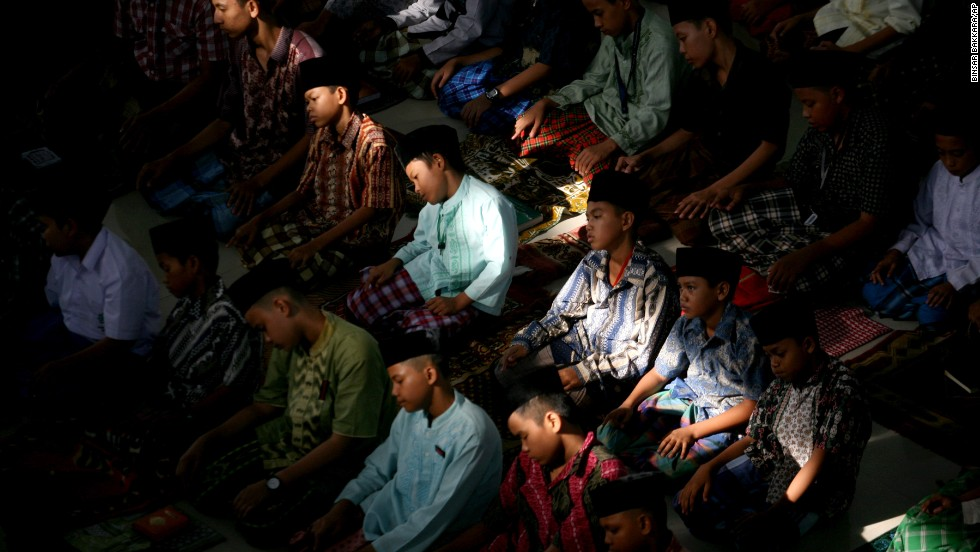 Students perform afternoon prayers at an Islamic boarding school on July 10 in Medan, Indonesia.