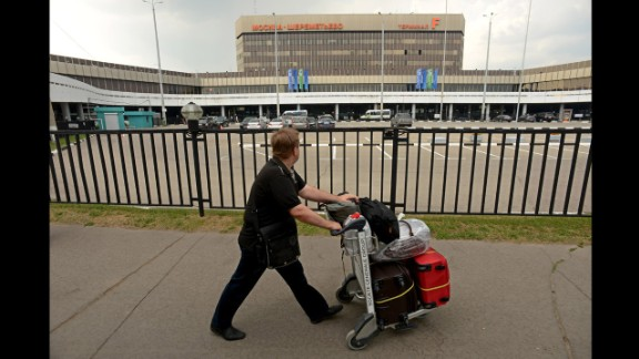 A man walks past Terminal F of Moscow's Sheremetyevo International Airport, where U.S. intelligence leaker Edward Snowden has been holed up since arriving June 23 from Hong Kong. The ex-National Security Agency contractor has admitted leaking classified documents about U.S. surveillance programs and faces espionage charges in the United States. In his first public appearance since arriving at Sheremetyevo, Snowden met with human rights activists and lawyers Friday, July 12, in the airport's transit zone. While it's still not clear if Russia will grant Snowden's temporary asylum request, he can leave the airport, Russian media report.