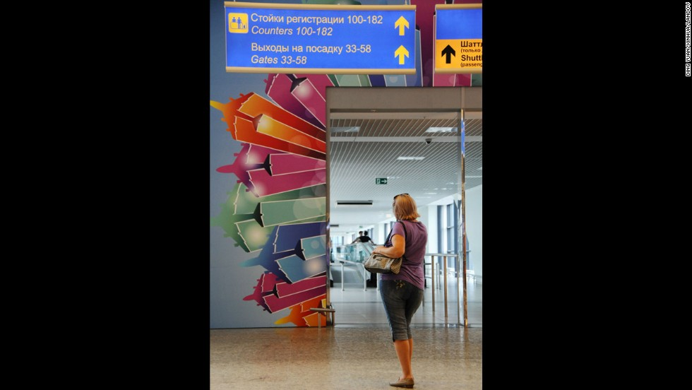 A woman stands at the entrance that links terminals D and E at Sheremetyevo.