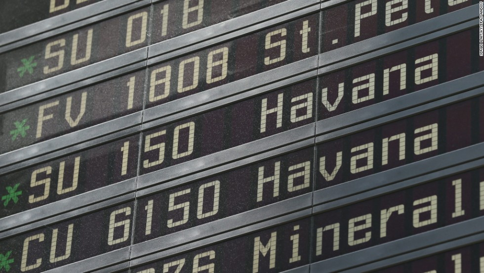 The departure board shows when a flight is leaving from Moscow to Havana, Cuba.