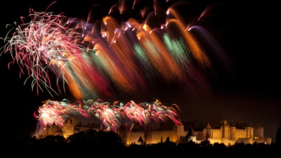 Photographer Martin Castellan, 62, took this color cascading photo of the Bastille Day fireworks in the city of Carcassonne in the south of France. Bastille Day is celebrated on July 14 and commemorates the storming of the Bastille prison in Paris in 1789 -- an event which triggered the French Revolution.   Mr Castellan says the city