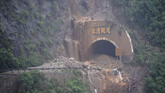 A road in Wenchuan county was destroyed by rain-triggered mudslides on July 10.