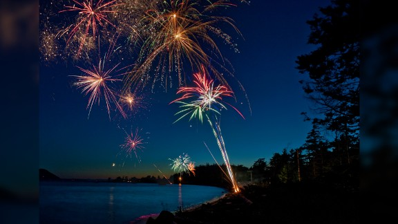 "Photographer Edmund Lowe captured this stunning photo of the fireworks over Legoe Bay, Lummi Island in Washington State on the Fourth of July in 2011. ""Fireworks make adults turn into kids again,"" he says. He also has some great tips for those wanting to capture iconic fireworks shots:   ""The main requirement is a tripod, I use a sandbag or some other heavy object to make sure there is no tripod shake. Long exposures, up to ten seconds are required. I generally use an f-stop of f/11 to f/16 and a shutter speed of two-ten seconds. The longer exposures will also give you time for multiple reports to be visible. This fills the sky with the sparkles."""