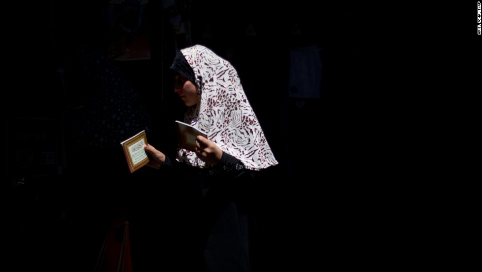 A woman makes her way to pray at the Al Aqsa Mosque in Jerusalem's Old City on July 12.