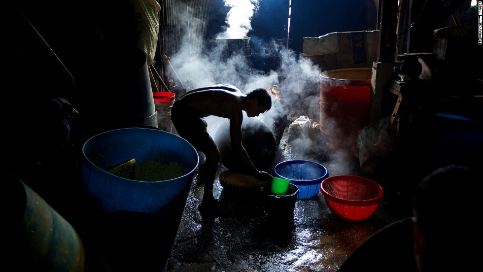A worker drains and rinses boiled soy beans at a small tempeh factory in Jakarta, Indonesia, on July 12. Tempeh is an Indonesian staple made from fermented soy beans. The Indonesian government has said that it will increase food imports during Ramadan to reduce inflation caused by increased food consumption leading up to the Eid Al Fitr holiday marking the end of the fasting month.