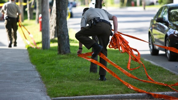 Police officers remove caution tape in areas of Lac-Megantic that were off-limits to residents. Since the July 6 derailment, wide areas of downtown have been restricted as authorities cleaned up and investigated the disaster site.