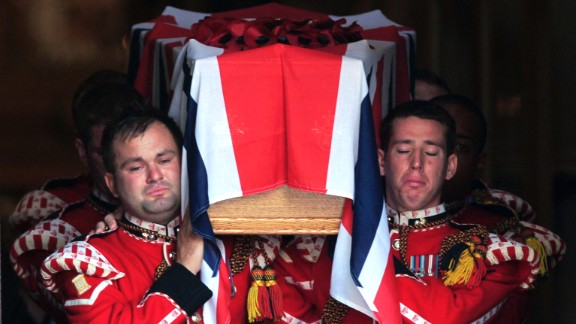 Following his funeral, Royal Fusiliers carry Rigby's coffin out of the Bury Parish Church, on Friday, July 12.