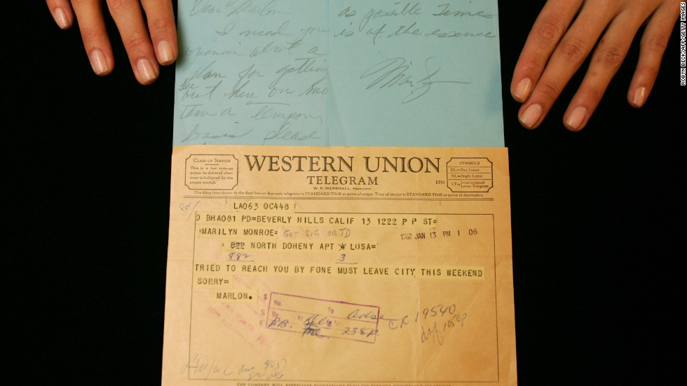 "A handwritten note from Marilyn Monroe to Marlon Brando and his return telegram are on display at Bonhams & Butterfields auction house in Los Angeles, California, on December 14, 2006. The note from Marilyn read: ""Dear Marlon, I need your opinion about a plan... please phone me as soon as possible. Time is of the essence, Marilyn."""