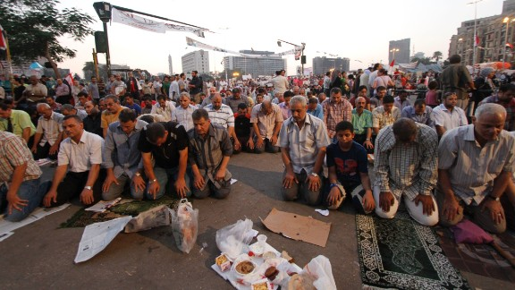 Egyptians in Cairo's Tahrir Square pray before breaking their fast on the third day of Ramadan, the sacred holy month for Muslims, on Friday, July 12.