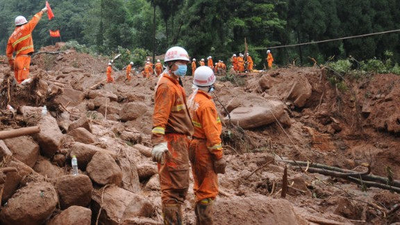 Rescuers work at the site of a massive landslide in Dujiangyan in southwest China