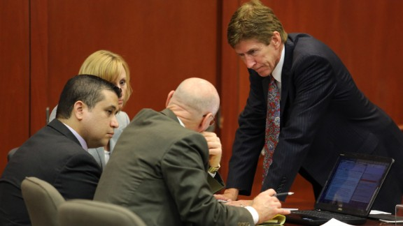 Zimmerman confers with his defense team on July 13, after working out the wording for a response to the jury, who had asked for clarification on the instructions regarding manslaughter. The response, crafted and agreed to by both the prosecution and defense, instructed the jury to ask their question more specifically, as the court could not engage in general discussion.