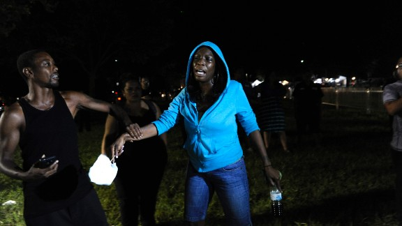 A Trayvon Martin supporter rallies outside the courthouse on July 13. After Martin's death, protesters started wearing hoodies in solidarity against racial profiling.