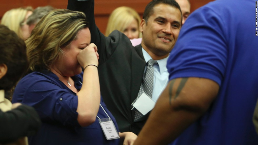 George Zimmerman's wife, Shellie Zimmerman, cries as friends and family members celebrate the verdict on July 13.