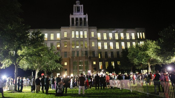 Demonstrators and members of the media gather outside of the courthouse on July 13. The jurors deliberated for more than 16 hours before delivering their verdict.