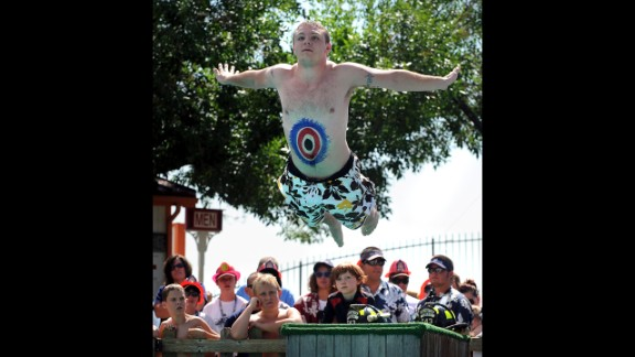 Gerald Magness flies through the air on his first of three belly-flops into the Calypso Cove pool in Federal Heights, Colorado, in 2009.
