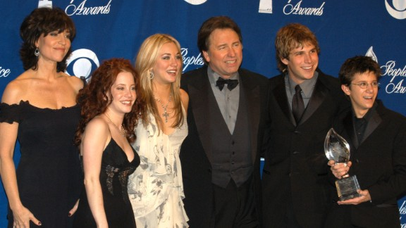 """John Ritter, center -- shown here with """"8 Simple Rules"""" cast mates (from left) Katey Sagal, Amy Davidson, Kaley Cuoco, Billy Aaron Brown and Martin Spanjers -- died of an aortic dissection at the height of the show in 2003. His character also died on the show and two additional cast members, David Spade and James Garner, were cast after a hiatus."""
