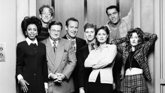 """The """"NewsRadio"""" cast, (from left), Khandi Alexander, Andy Dick, Stephen Root, Phil Hartman, Dave Foley, Maura Tierney, Joe Rogan and Vicki Lewis were pretty tight prior to Hartman's death. Hartman, who was shot to death by his wife in 1998, was revealed to have died of a heart attack at the beginning of the fifth season, and Hartman was replaced by actor Jon Lovitz."""