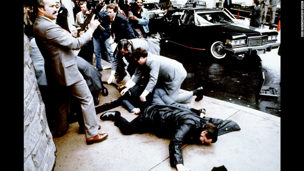 On March 30, 1981, John Hinckley fired six shots at Reagan as he exited a Washington hotel with his entourage. Police officer Thomas Delahanty (foreground) and Press Secretary James Brady (behind) lay wounded on the ground. Reagan was hit by one of the bullets and was hospitalized for 12 days. He fully recovered.