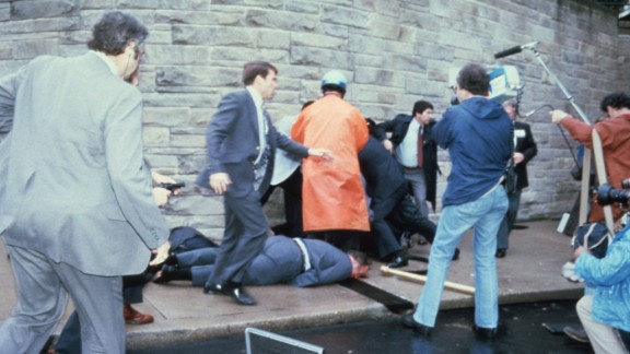 As people storm the scene of the crime, Reagan is rushed to George Washington University Hospital in a split-second decision that possibly saved his life. The bullet penetrated within an inch of the president