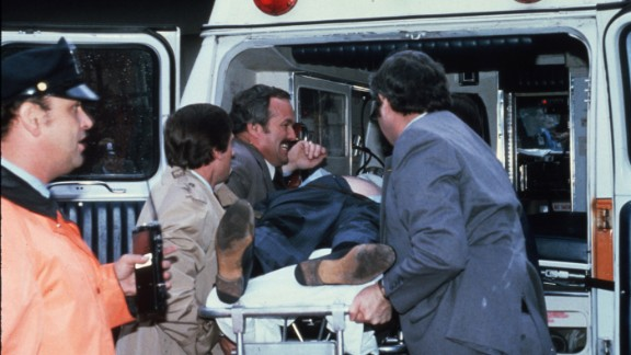 Brady is placed into an ambulance after the shooting. He suffered severe brain trauma and was unable to return to his post at the White House.