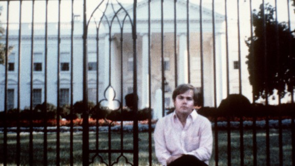 Hinckley poses for a photo in front of the White House. A federal judge committed Hinckley to St. Elizabeth