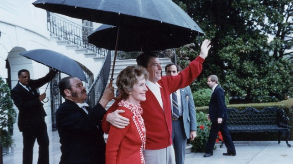 """After the attack, Reagan joked with his wife saying he """"forgot to duck"""" and asked the attending doctors if they were Republicans.  The president and first lady seen here outside the hospital."""