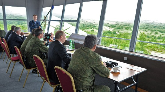 Putin, center, and Russian military personnel observe exercises on July 16.