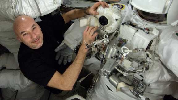 Astronaut Luca Parmitano performs a series of checks on his spacesuit on Monday, July 15, the day before the spacewalk.