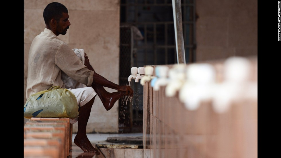 A man washes his feet before noon prayers at a mosque in Karachi, Pakistan, on July 16.