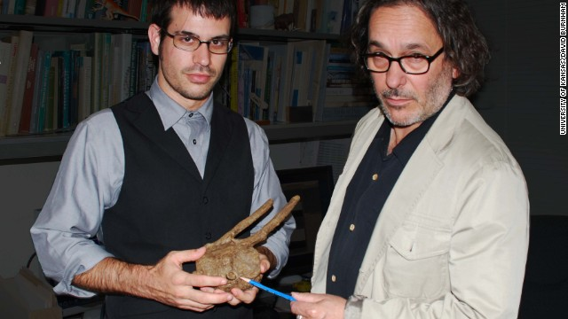 Robert DePalma, left, and David Burnham on right, show  the Tyrannosaurus rex tooth.