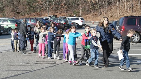 Connecticut State Police evacuate Sandy Hook Elementary School in Newtown, Connecticut, in December 2012. Adam Lanza opened fire in the school, killing 20 children and six adults before killing himself. Police said he also shot and killed his mother in her Newtown home.