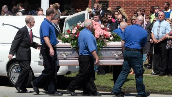 Pallbearers carry a casket of one of Michael McLendon's 10 victims. McLendon shot and killed his mother in her Kingston, Alabama, home, before shooting his aunt, uncle, grandparents and five more people. He shot and killed himself in Samson, Alabama, in March 2009.