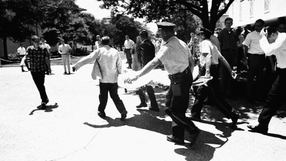 Officers in Austin, Texas, carry victims across the University of Texas campus after Charles Joseph Whitman opened fire from the school