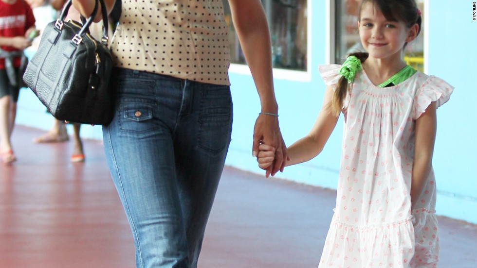 Katie Holmes holds hands with daughter Suri at NYC's Chelsea Piers on July 15.