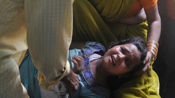 A grief stricken mother is consoled after the death of her son.
